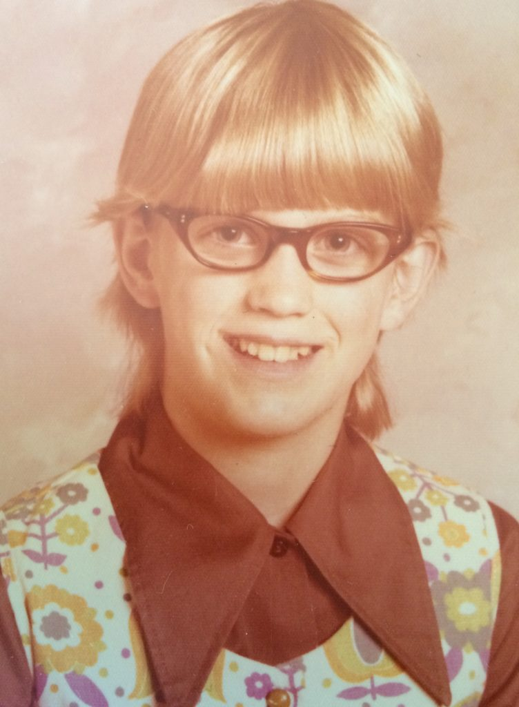 4th grade school picture I now have four-eyes, cry too easily (pretty girls should smile!), and not musically gifted or athletically inclined. I hate school and myself because I am slow, dumb, stupid. In a family where relationships are transactions -- What do you have to offer? How will you make us proud? -- I have nothing. The trinity of my body, mind, spirit fractures a bit more.