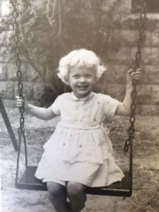 four year old on a swing